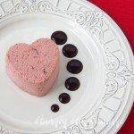 Cranberry orange Semifreddo Hearts served with chocolate ganache for Valentine's Day.