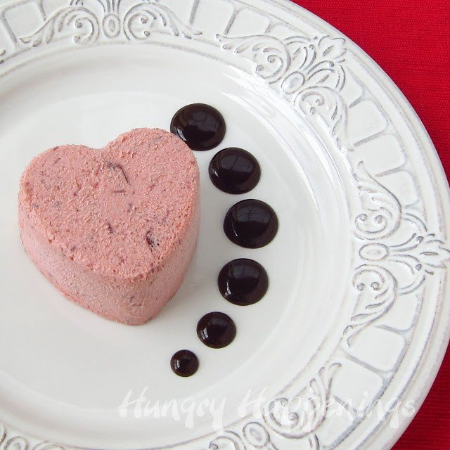 Cranberry orange Semifreddo Hearts served with chocolate ganache for Valentine's Day.