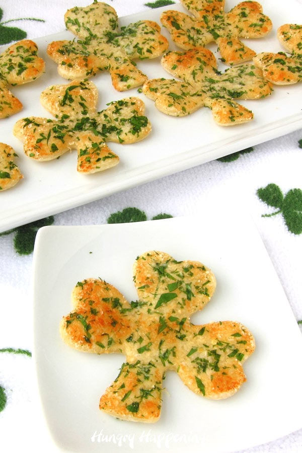 Parmesan cheese and parsley topped crackers shaped like shamrocks for St. Patrick's Day