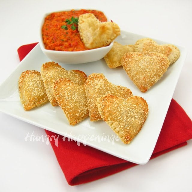 Everybody's heard of Mozzarella Sticks but how about Mozzarella Cheese Filled Hearts with Roasted Red Pepper Pesto! This dish is perfect for your appetizer loving friends and family, they will enjoy every cheese filled bite.