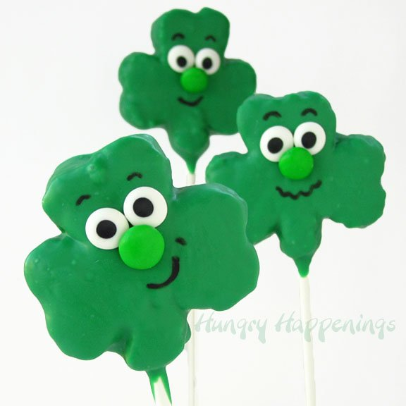 If you want to make a cute treat with your kids this St. Patrick's Day try out these Silly Shamrock Shaped Rice Krispies Treat Pops! Your kids can even make their own silly faces on these treats!