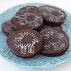 Cute Easter cookies made using a stamp. Imprint modeling chocolate to make these Stamped Sheep Cookies.