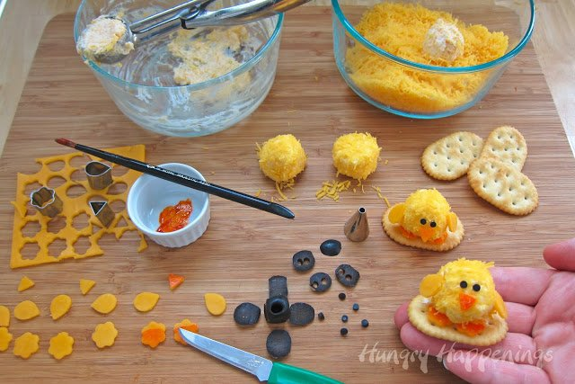Get festive this Easter and make these adorable Easter Appetizers - Baby Chick Cheese Balls! These bite sized balls of fun are so cute and the perfect size to pop right in your mouth!