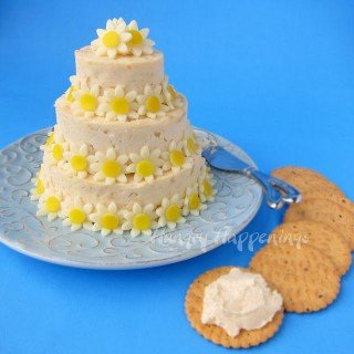wedding cake cheese ball appetizer with daisy-shaped cheese