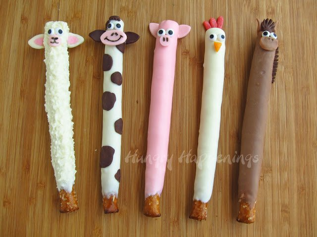 Chocolate Pretzels decorated like farm animals including a sheep, cow, pig, chicken, and horse.