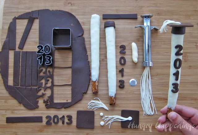 How to make graduation pretzel pops using white chocolate pretzels and modeling chocolate.