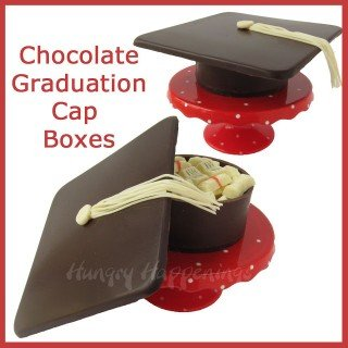 Chocolate graduation cap boxes filled with candy and cash.