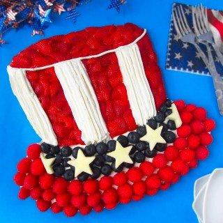 4th of July Fruit Pizza decorated like Uncle Sam's Hat