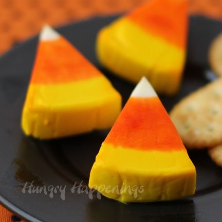 Turn a plain piece of cheese into an amazingly festive Halloween appetizer! This Laughing Cow Candy Corn Cheese is so simple but is the perfect addition to any Halloween party!