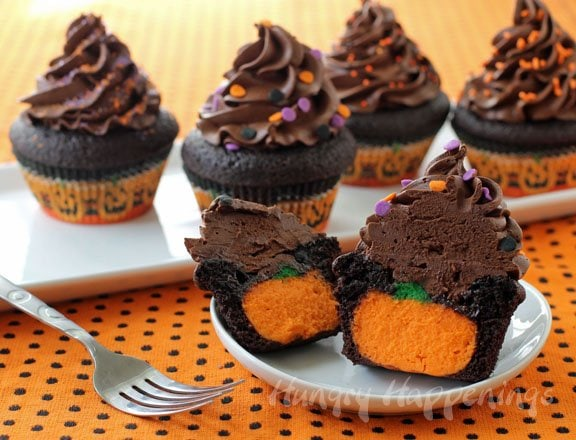 You absolutely have to make these fan favorite Ultimate Cheesecake Stuffed Halloween Cupcakes for your spooky party! These delicious treats will have everyone wondering how you got such an adorable surprise inside!