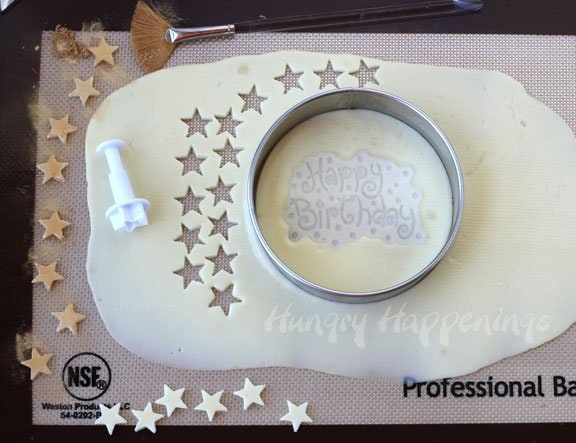 How to cute and stamp cheese for a cheese ball birthday cake.