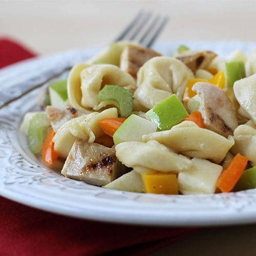 The blend of cheese filled pasta with tart Granny Smith apples, crunchy peppers and celery, savory grilled chicken in this Honey Mustard Tortellini Pasta Salad is so flavorful that you'll make this recipe over and over again.