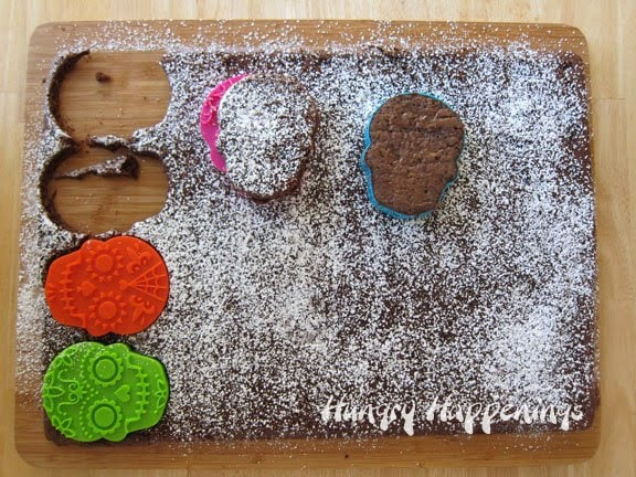 Use a cookie stamp to create sugar skull brownies for Dia de los Muertos.