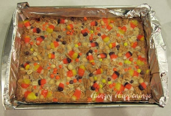 These Halloween Sweet and Salty Candy Corn Magic Bars are great for a last minute dessert! This simple dessert is a must have at any party, you won't be able to get enough!