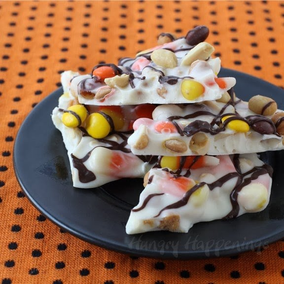 Sweet and salty Halloween chocolate bark filled with candy corn, peanuts, caramel, and Reese's Pieces.