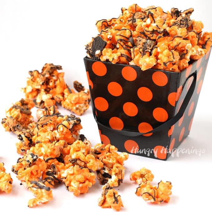 Orange and Black OREO Cookie and white chocolate Halloween popcorn in a black and orange polka dot gift box.