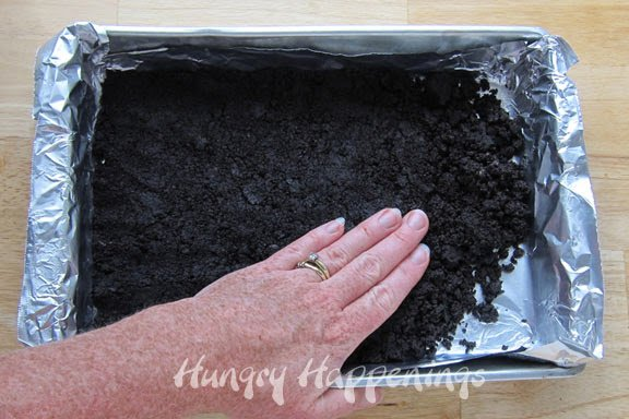 press OREO crumbs mixed with melted butter into baking pan