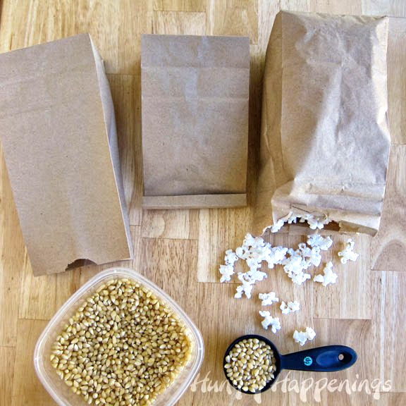pop corn kernels popped in a brown paper bag in the microwave