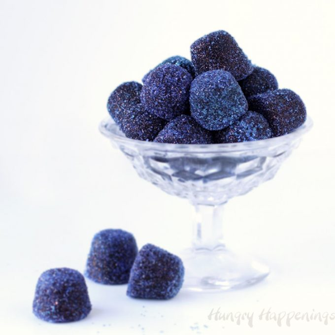 Homemade blueberry gumdrops in a clear candy dish.