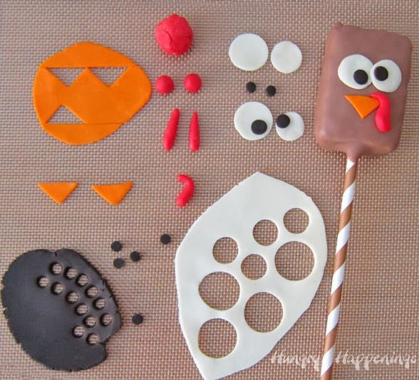 Decorate Rice Krispie Treat Turkeys with modeling chocolate.