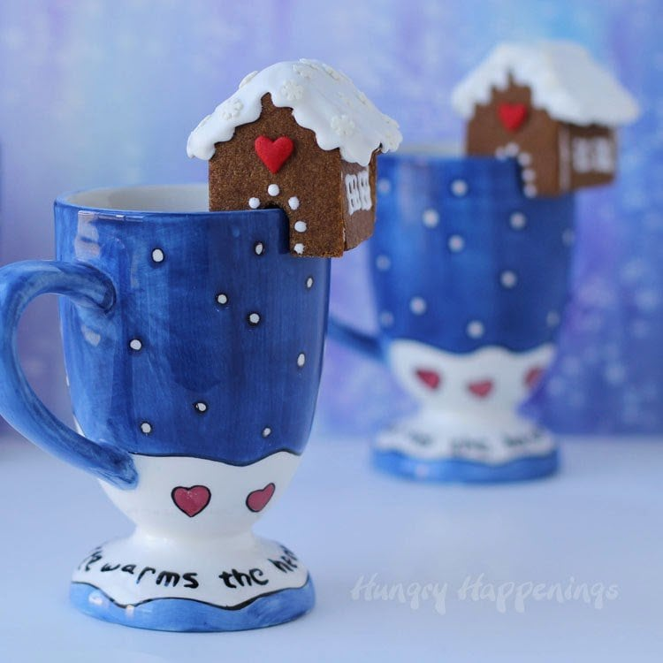 Who could resist little cookies sitting on top of your mug filled with hot chocolate or coffee? No one!! That's why these Mini Gingerbread Cookie Houses are perfect for people of all ages.