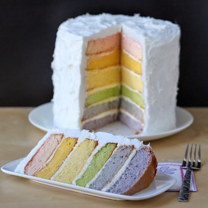 Use fruit and vegetable purees to decorate this beautiful Naturally Colored Rainbow Cake. Each colorful layer of white cake is stacked with frosting in between into a towering dessert that will really impress.