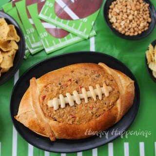 Football Bread Bowl filled with Taco Dip