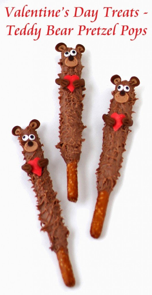 Teddy Bear Pretzel Pops - Cute fuzzy chocolate teddy bears holding hearts will warm the hearts of kids and adults. Tutorial at HungryHappenings.com