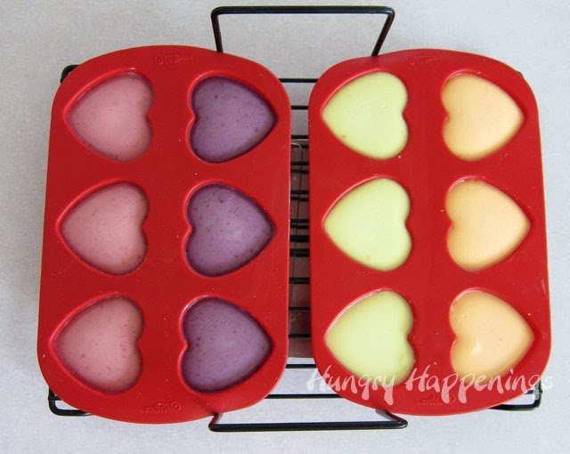 naturally colored cheesecake hearts baked in a silicone heart mold