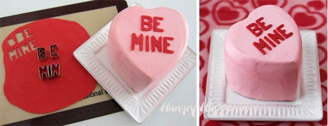 "cut out red modeling chocolate letters and decorate a conversation heart cake to say ""be mine"""