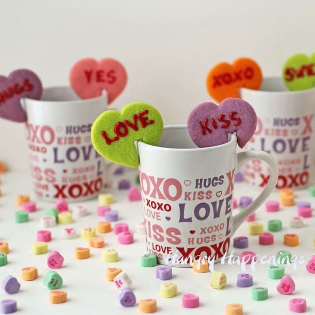 Add a little extra flare to your hot chocolate or coffee with these Conversation Heart Mug Hug Cookies and make sure to dip them in to really get the full flavor of these scrumptious treats.