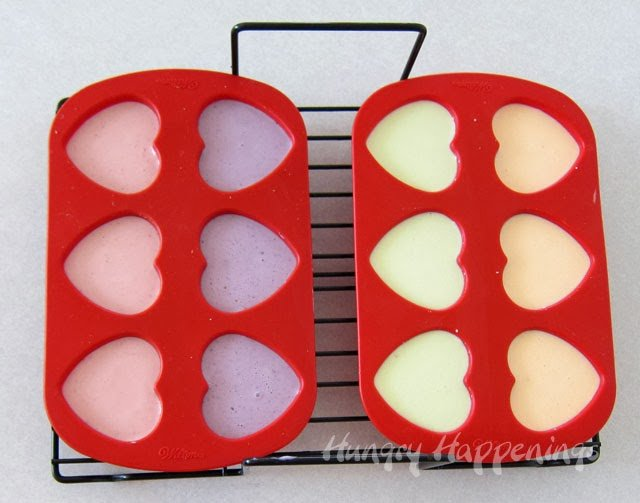 silicone heart molds filled with naturally colored cheesecake filling