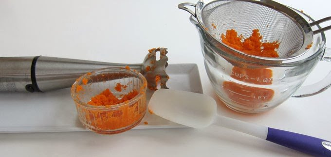 blending carrots and pressing through fine-mesh strainer for carrot puree