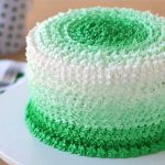 cake decorated with green ombre frosting piped using a star tip
