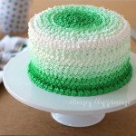Green ombre cake with layers of creme de menthe cake and chocolate frosting.