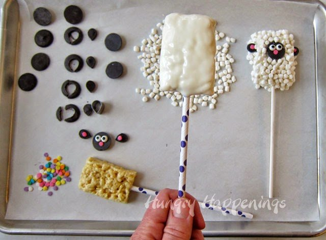 Everyone loves Rice Krispies Treats, so why not make them into a festive Easter basket candy! These adorable Rice Krispies Treat Lamb Pops might be too cute to eat, but once you take one bite you wont be able to stop!