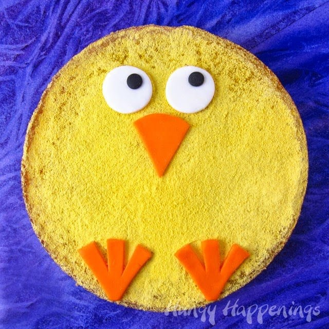 Large round lemon bar decorated like a chick for Easter dessert.