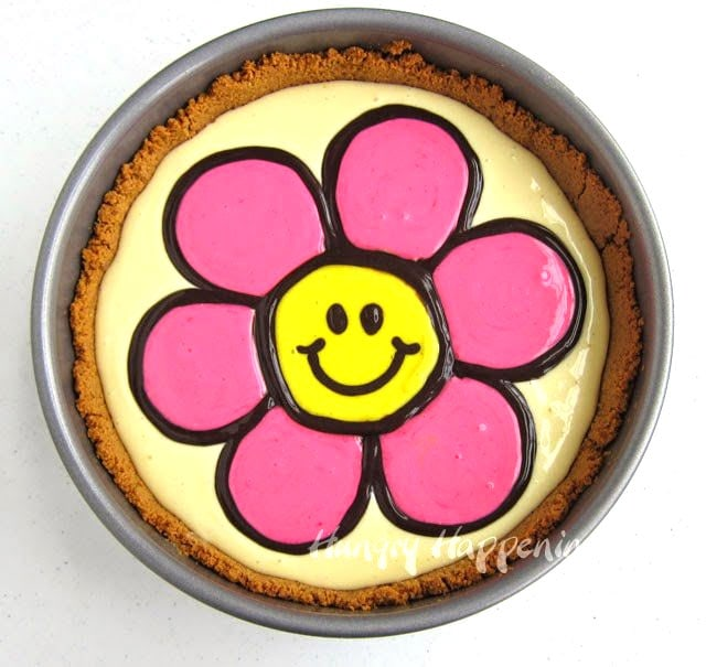 pipe the smiley face using black cheesecake filling over the yellow daisy center