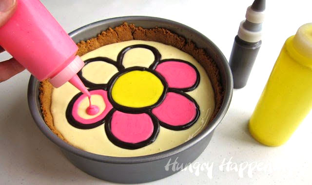pipe pink cheesecake filling into each of the daisy petals