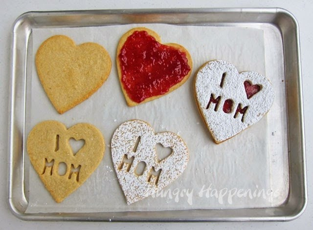 These Raspberry Linzer Cookie Hearts for Mom are the perfect treat to show your mom you care about her on Mother's Day. This sweet dessert will have your mouths watering and unable to get enough!