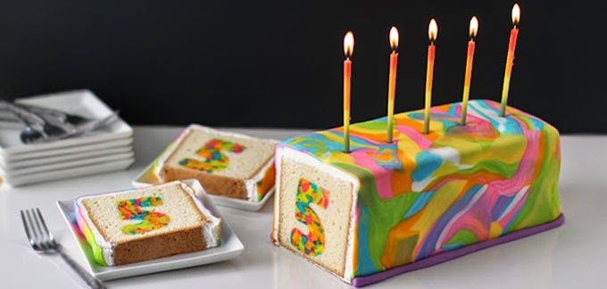 Rainbow Tie-Dye Surprise Cake to celebrate a 5th birthday.
