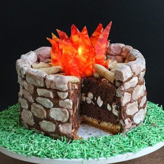 Campfire S'mores Cake with Cookies 'n Cream Fudge Rocks and Candy Flames
