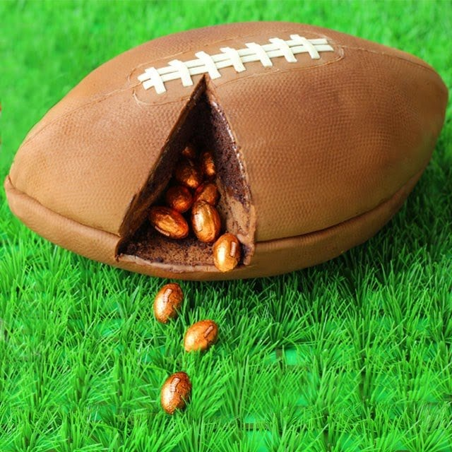 3-D Game Day Football Cake filled with Chocolate Footballs | HungryHappenings.com