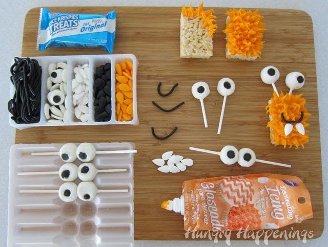 Decorate rice krispie treats using orange frosting, licorice smiles, candy teeth, and gummy candy eyes.