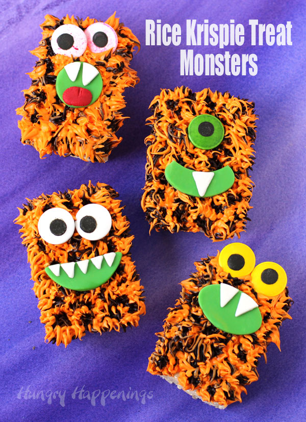 Orange and black frosting covered rice krispie treat monsters for Halloween.