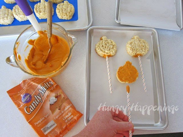 Pumpkin Spiced Candy Coated Rice Krispie Treats   HungryHappenings.com