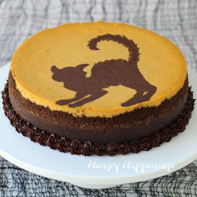 Black Cat Cheesecake (A painted chocolate and pumpkin cheesecake) | HungryHappenings.com