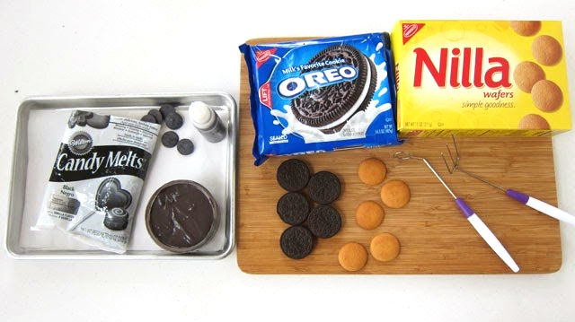 Black Candy Melts, OREO Cookies, and Nilla Wafers with chocolate dipping forks