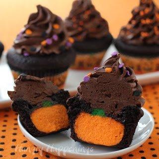 pumpkin cheesecake stuffed chocolate cupcakes topped with a swirl of chocolate ganache