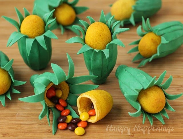 Candy Filled Ear of Corn Cookies will add a touch of whimsy to your Thanksgiving dessert table. | HungryHappenings.com